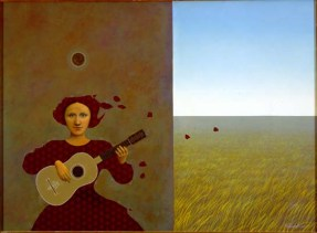 A woman plays a guitar in front of a wall and a field of grass.