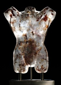 A cast glass torso of Saint Sebastian .