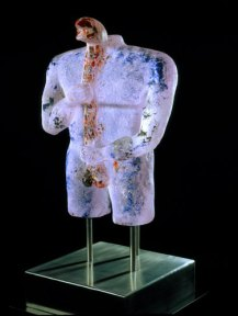 A cast glass sculpture of a torso with a snake crawling up its torso.