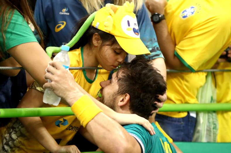 RIO DE JANEIRO, BRAZIL - AUGUST 07:  Diogo Kent Hubner of Brazil kisses his daughter Clara  during the Mens Preliminary Group B match between Poland and Brazil at the Future Arena on Day 2 of the Rio 2016 Olympic Games at the Future Arena on August 7, 2016 in Rio de Janeiro, Brazil.  (Photo by Phil Walter/Getty Images)