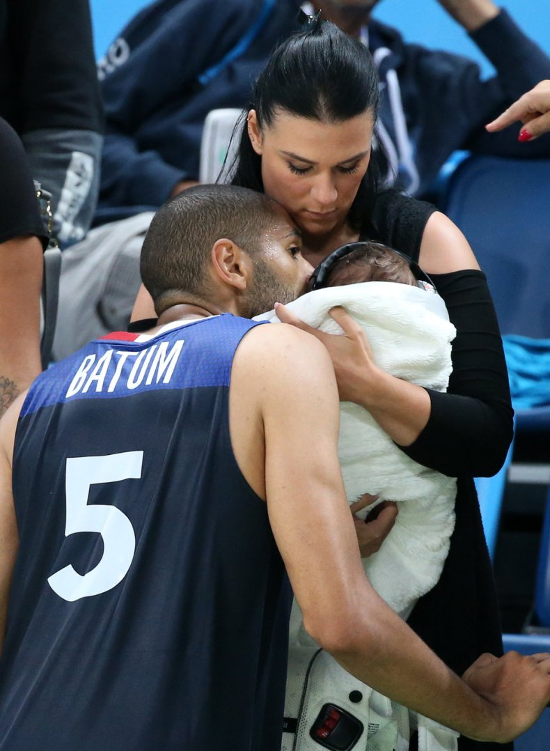 RIO DE JANEIRO, BRAZIL - AUGUST 10: Nicolas Batum of France meets Aurelie and their 7 months old baby son Ayden Richard Batum following the men's basketball match between France and Serbia on day 5 of Rio 2016 Olympic Games at Carioca Arena 1 on August 10, 2016 in Rio de Janeiro, Brazil. (Photo by Jean Catuffe/Getty Images)