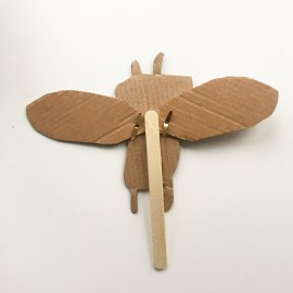 Moveable moth craft using split pins and lolly stick.
