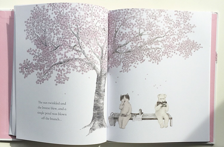 Cat and Dog on bench in the book In Blossom