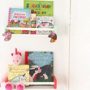 Book shelf filled with unicorn picture books and activities. MammaFilz.com