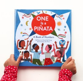 Book cover shot of a book of Numbers, one is a piñata.
