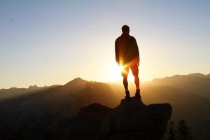 man-standing-sunrise