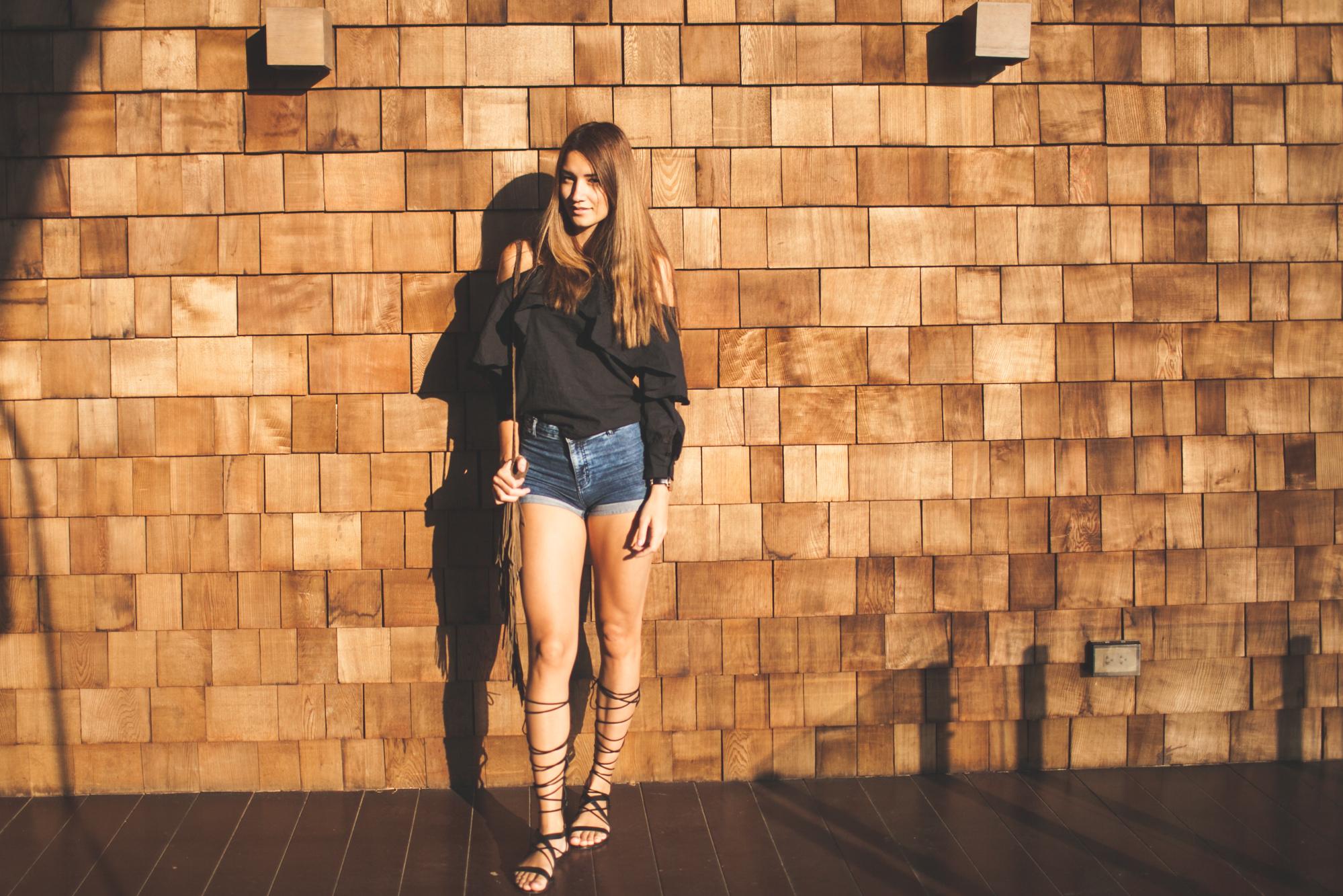 girl standing next to wall at puri pai villa