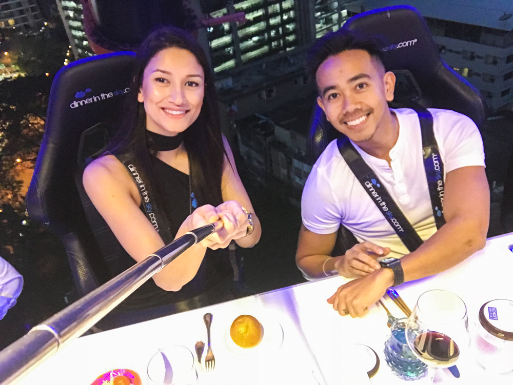 Couple taking selfie in the air at dinner in the sky bangkok