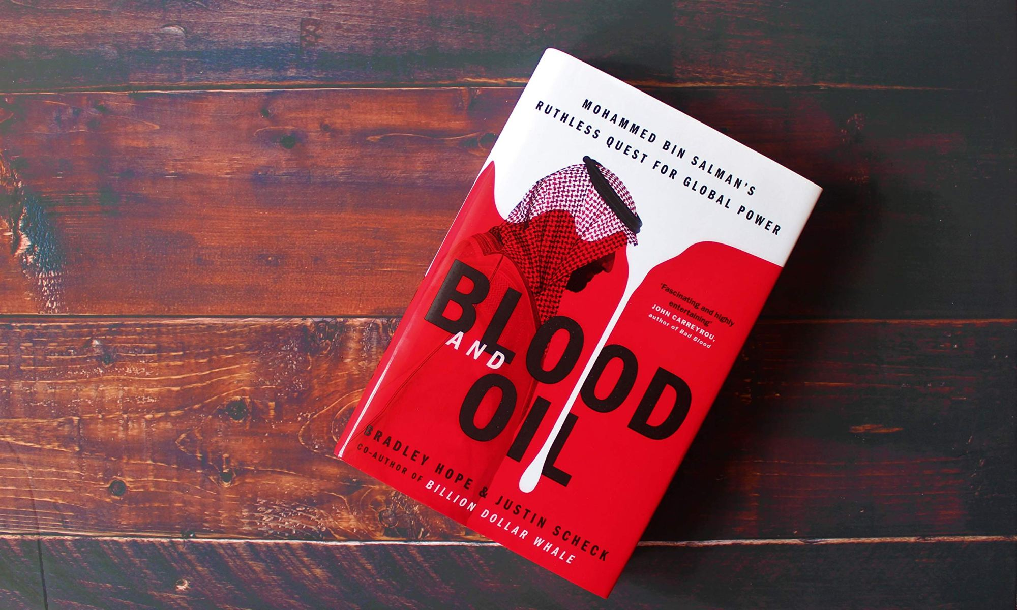 Blood and Oil book cover on hardwood floor.