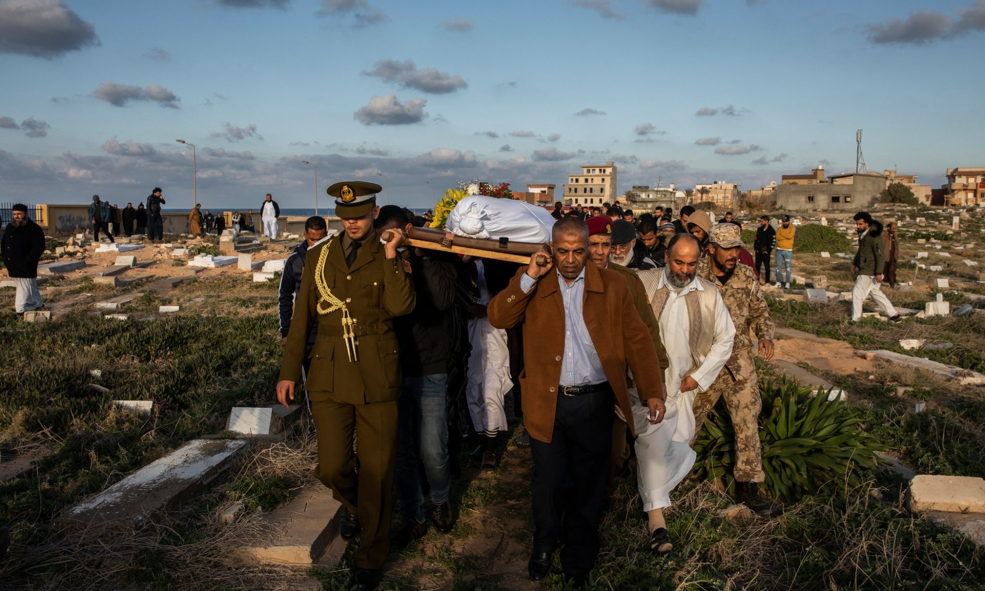 People carrying coffin at funeral in Libya