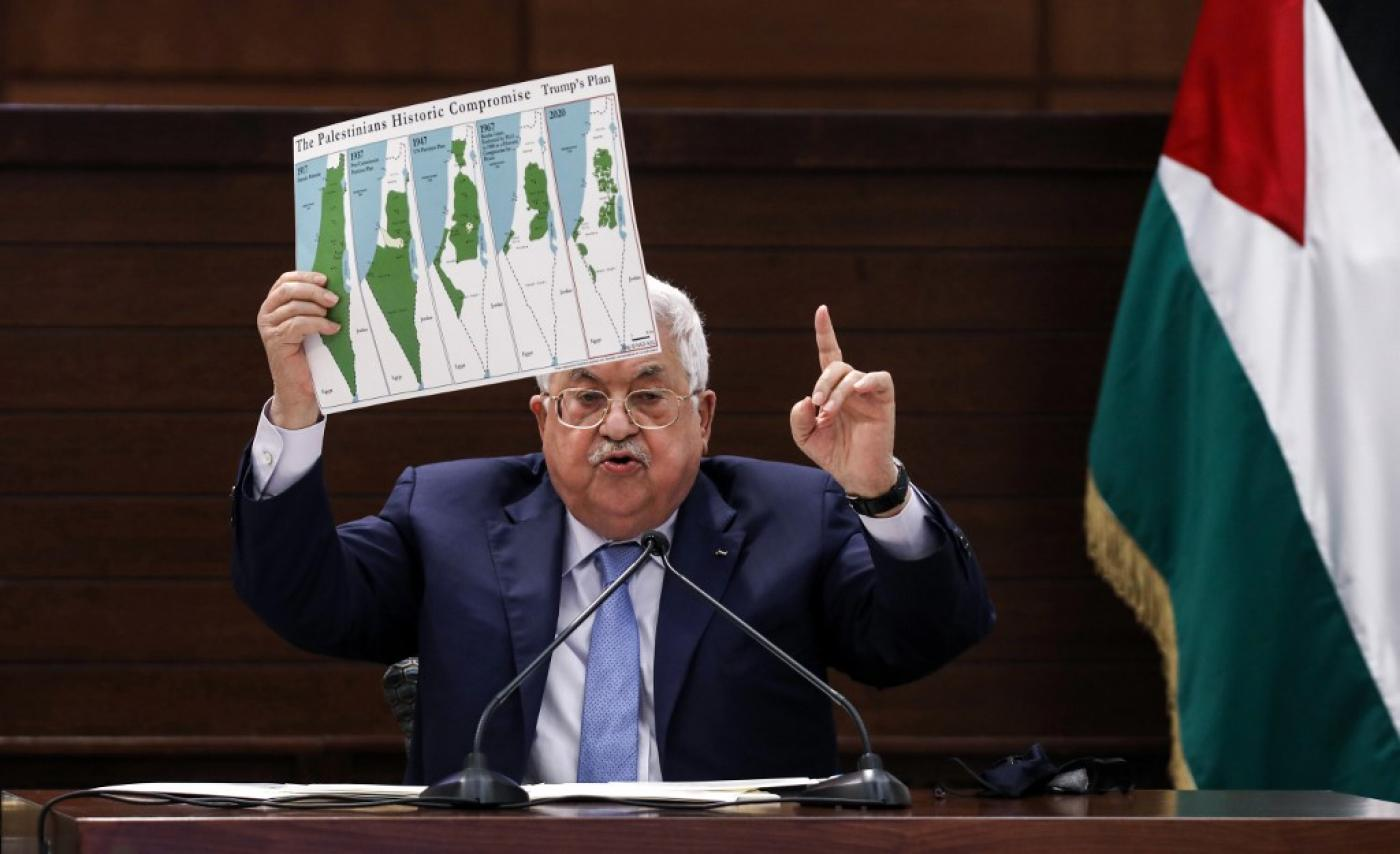 Mahmoud Abbas holding up placard at the UN.