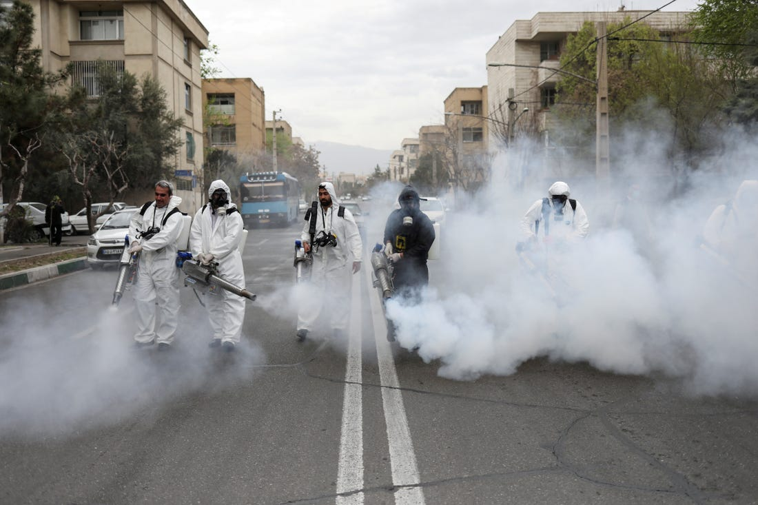 Personnel disinfecting streets in Iran.