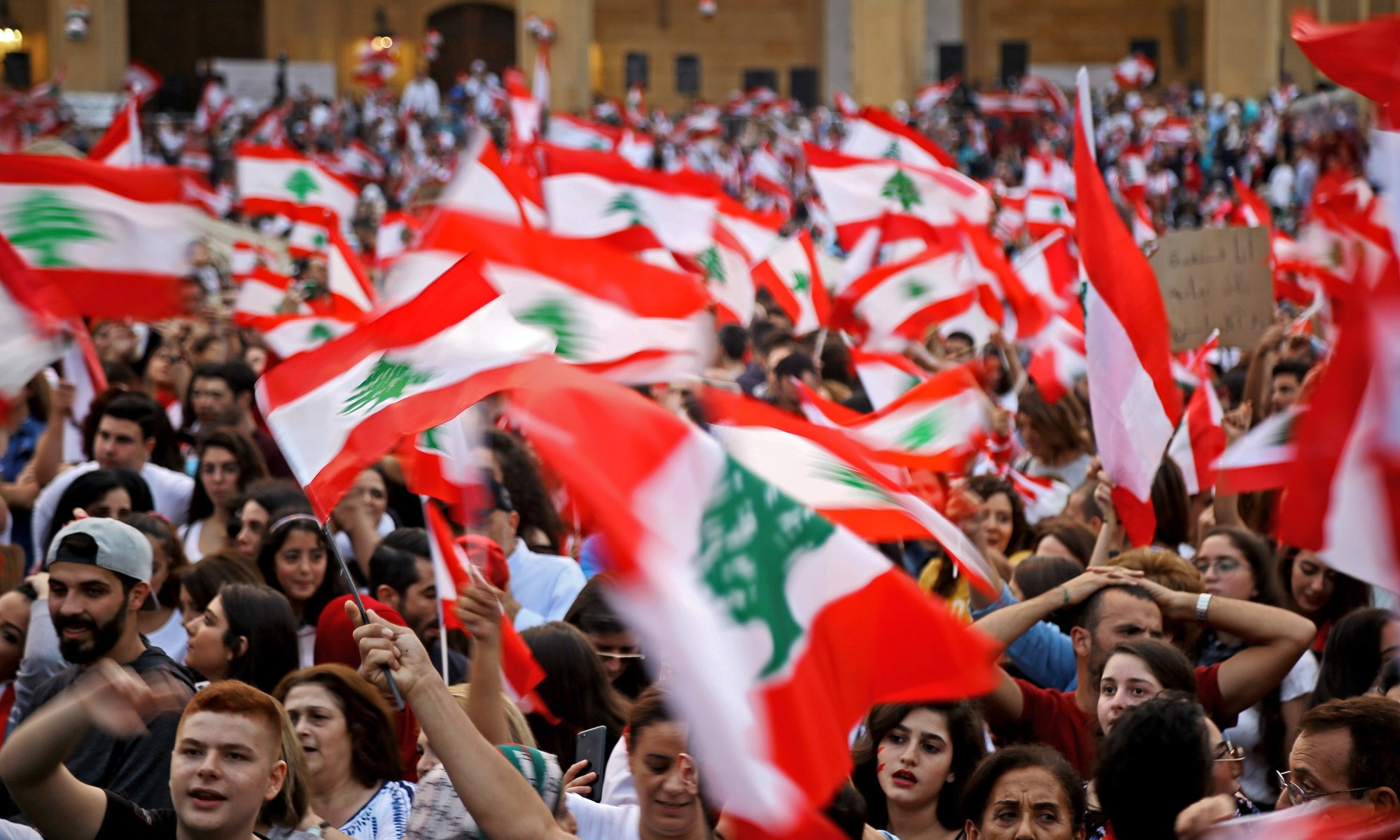 People waving Lebanese flags.