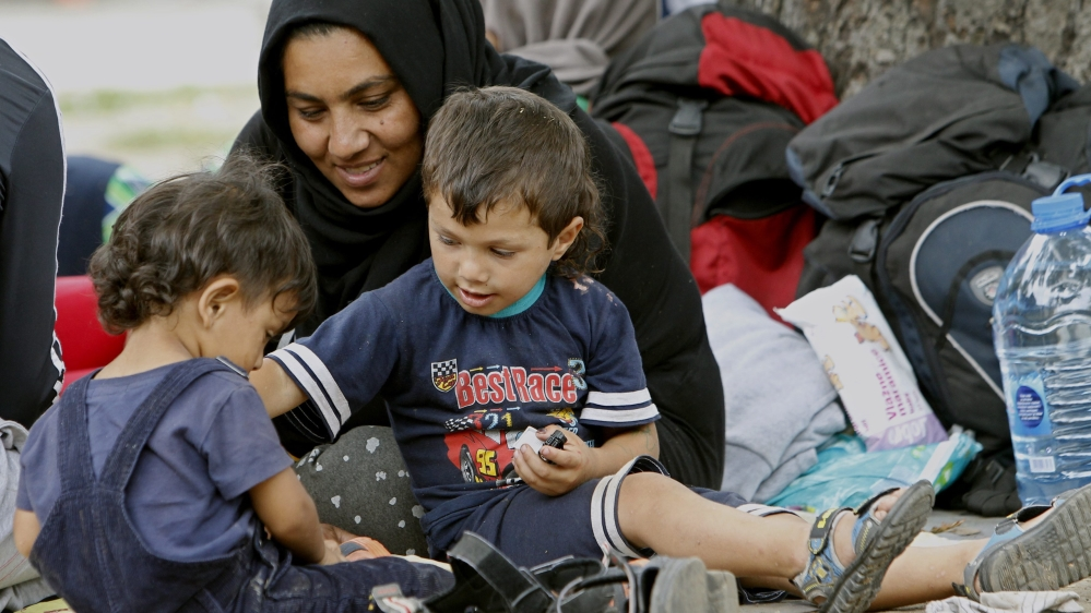 Mother with children in refugee camp.