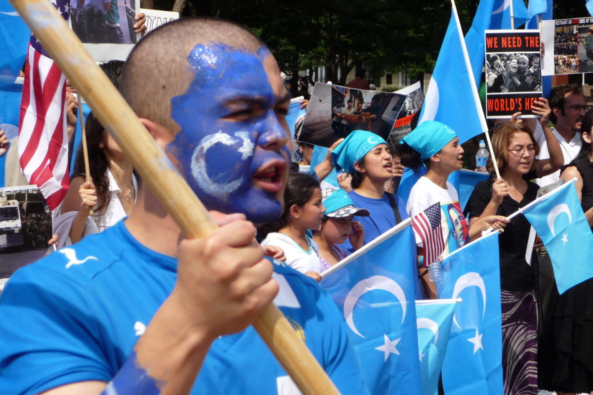 Uighurs protesting waving flags.
