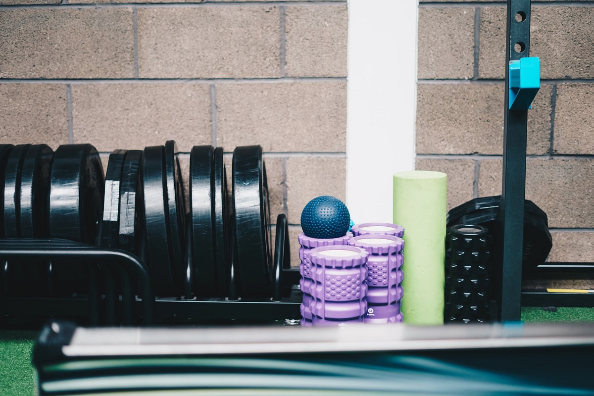gym equipment placed near wall in a small home gym