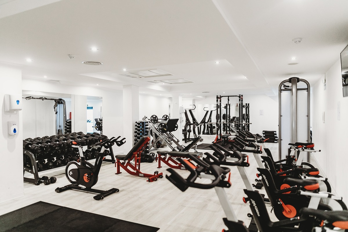 different types of gym equipment placed in a large room