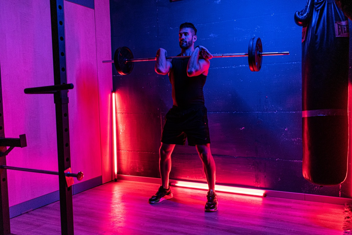 man doing workout in beautiful lighting home gym