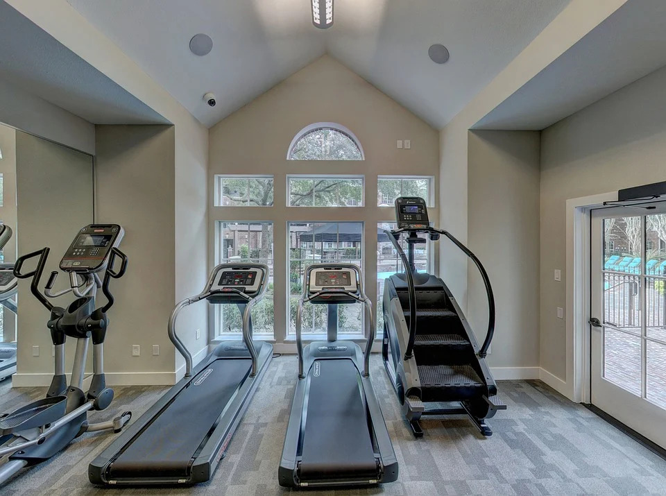 home workout gym machines on wooden floor