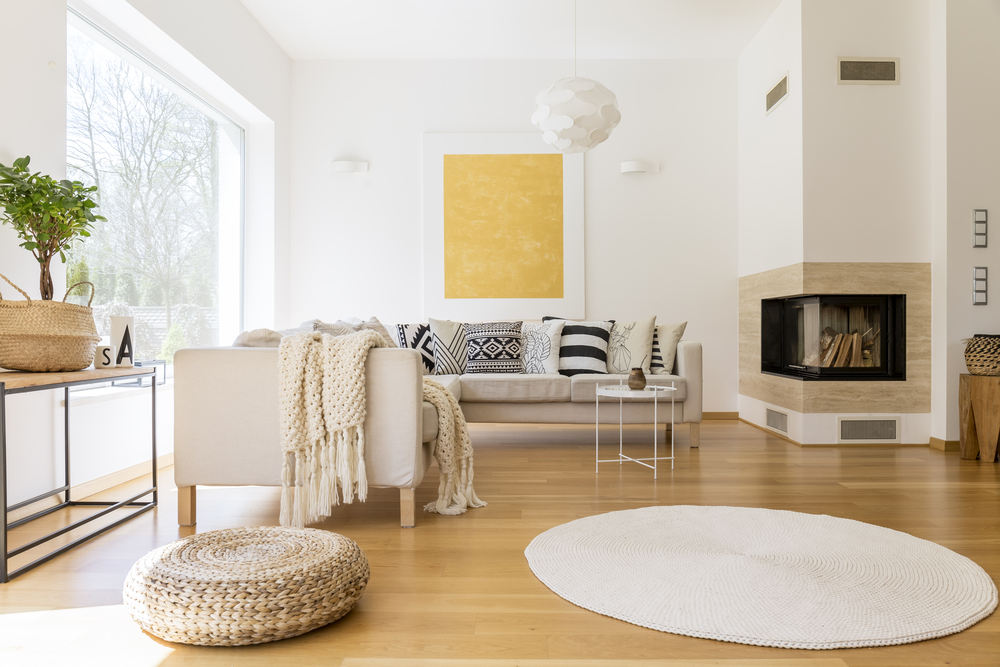 spacious white and wooden living room with modern fireplace