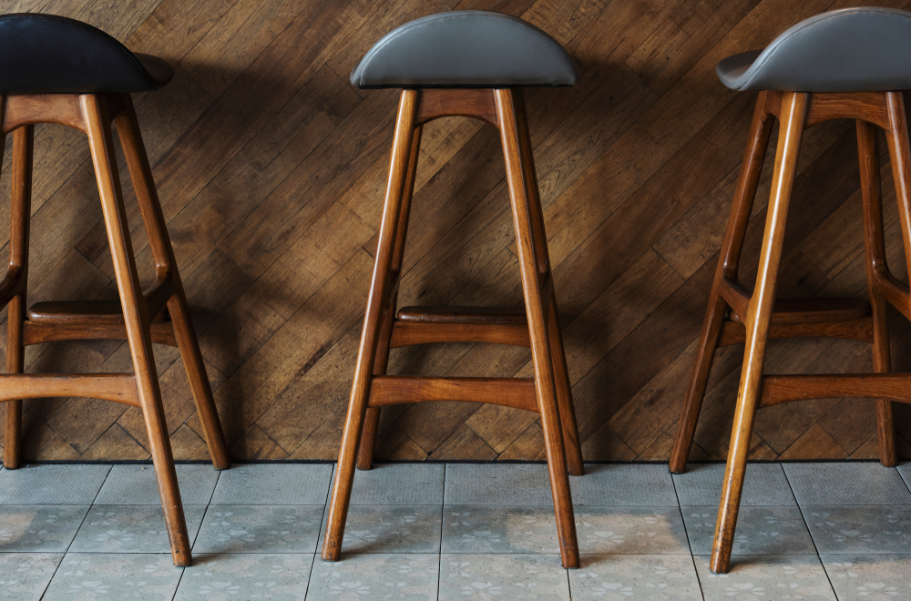 modern tall wooden bar stools placed in bar