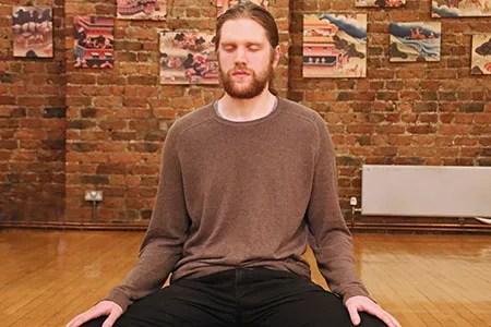 photo of man meditating