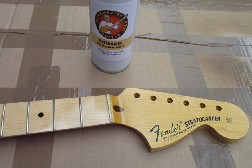 The yellowed headstock face