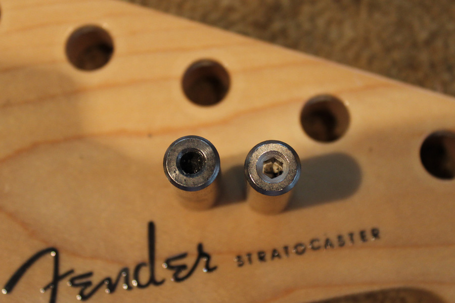 Comparing old and new truss rod nuts, old one is very worn.