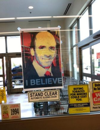 Portraits of Arthur T. DeMoulas are posted inside the Manchester store.