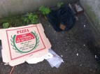 Empty pizza box and a pair of jeans.