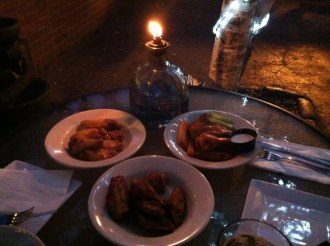Trio of wings by candlelight.