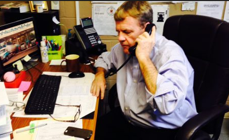 Fred Fuller fields calls in his office in 2013.