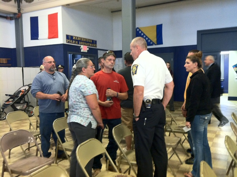 Christopher Gagnon's family speaks with Asst. Chief Nick Willard during a recent Manchester Police event. Their son, Christopher, was stabbed to death in February 2014.