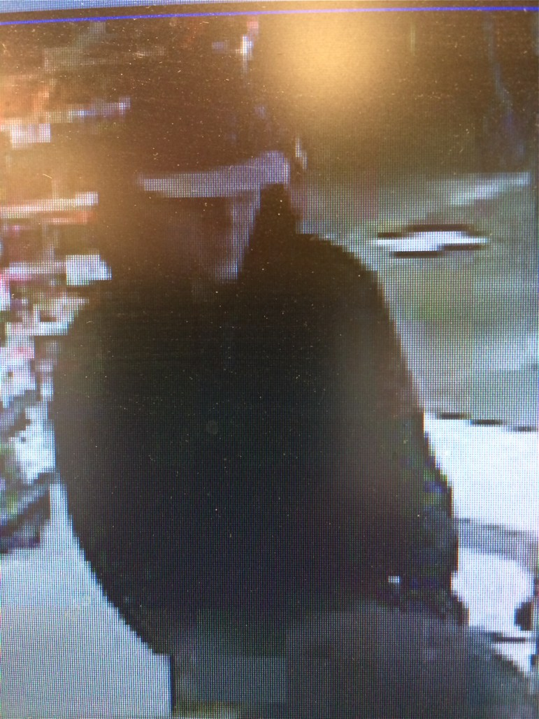 Image of robber from Cumberland Farms surveillance video.