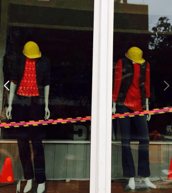 The owner of CC's Consignment tried to have a sense of humor about the construction, using hard hats and caution tape in her display window.