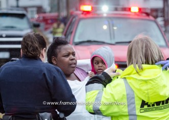 A woman is reunited with her daughter following a fast-moving fire that claimed a neighbor's life.