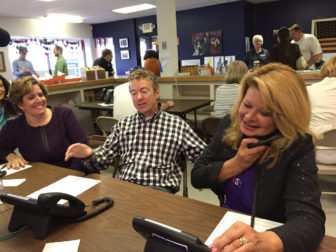 GOP Chair Jennifer Horn, left, with U.S. Sen. Rand Paul, R-KY, center and Gail Huff, Scott Brown's wife, manning the phones in Manchester.