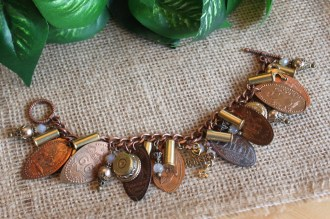 Bracelet that's ready for posting on Etsy, using flattened pennies, bullets and other curiosities.