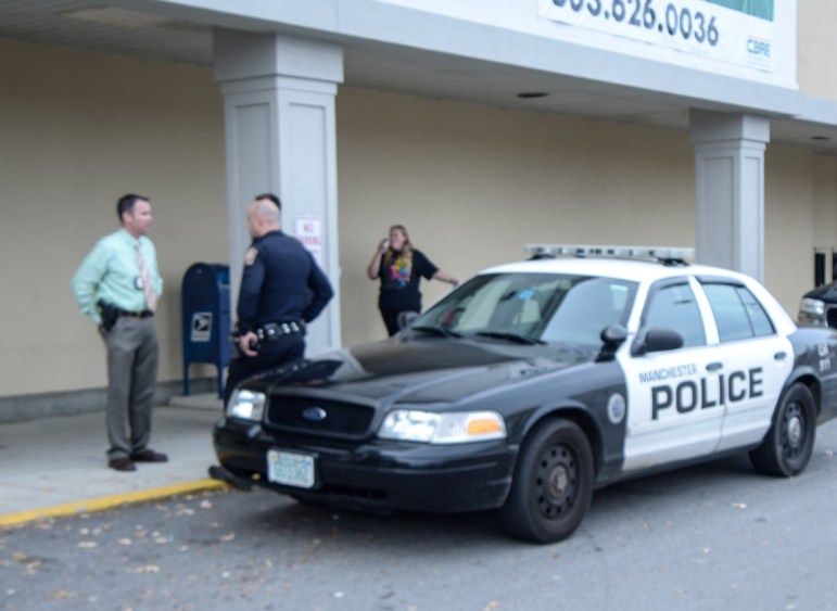 Police respond to robbery at Rite Aid on McGregor Street.