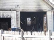 Fire Chief Michael Gamache estimates $30,000 in damage to detached garage.