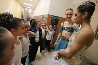 "Misty Copeland, far right, of the American Ballet Theatre and a few of her colleagues, including Catherine Hurlin, next to her at center, were performing this weekend with the New England Dance Ensemble's sold-out performances of ""The Nutcracker,"" at Windham High School. Copeland and her colleagues participated in the dress rehearsal on Friday evening and talked with the dancers every chance they got. Photo by Allegra Boverman"