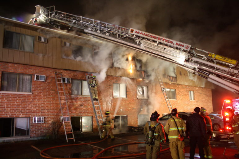 Manchester firefighters battle the Dec. 21 blaze at 65 Log Street.