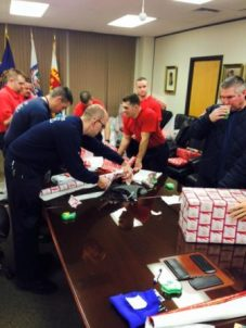 Wrapping Adopt-a-Family gifts at Manchester Fire Department.