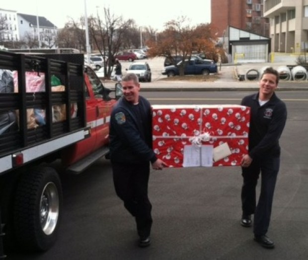 Members of the Manchester Fire Department with a special delivery.
