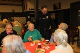 Officer Mark Ampuja makes the rounds during the Christmas party.