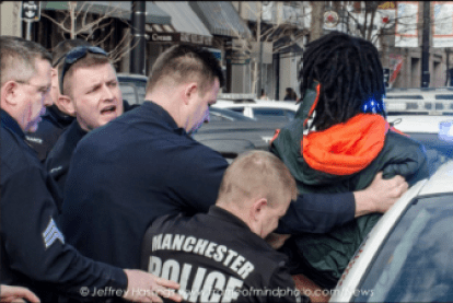 Police attempt to handcuff ; Lovensky Jonick Maschabaz-Mesidor, who faces several charges.