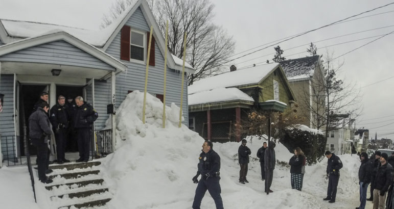 City officials investigate a complaint of an illegal rooming house on Lowell Street.