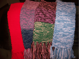 Scarves knitted by Louise LaFerriere for the Scarves in the Park initiative.