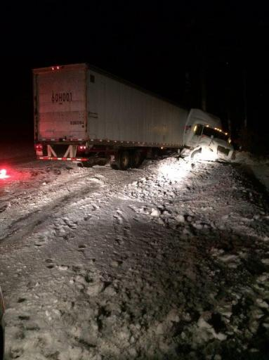 Driver of jackknifed tractor trailer was cited for speeding on sloppy Everett Turnpike.