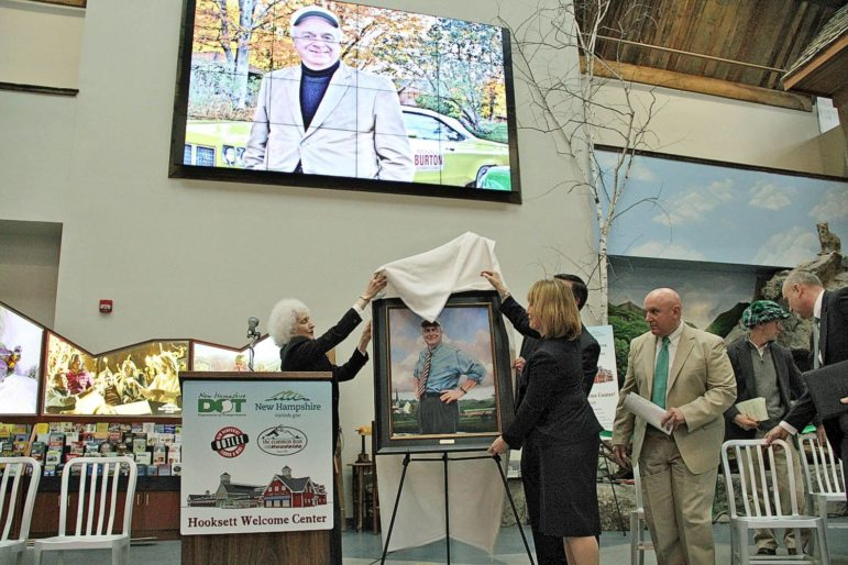 Gov. Maggie Hassan and Joan Day, Ray Burton's sister, unveil Burton's portrait at the welcome center dedication ceremony on March 17.